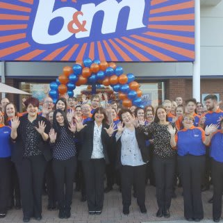 Store staff pose outside their new B&M Congleton store, located at Congleton Retail Park.