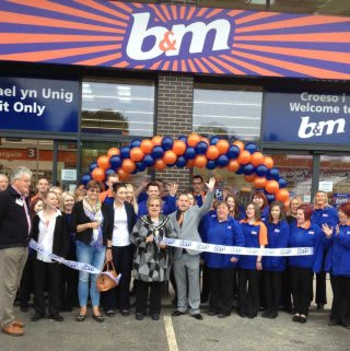 The ribbon being cut at B&M Welshpool by Deputy Mayor, Hazel Evans, and Rosanne Corfield from the Heulwen Trust.