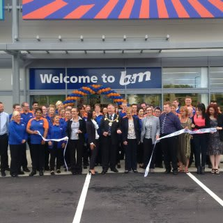 Local Mayor, David Wildey cuts the ribbon to officially declare the new B&M Strood store 'open'.