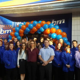B&M Ashford's store team pose proudly outside their brand new Bargains store on High Street.