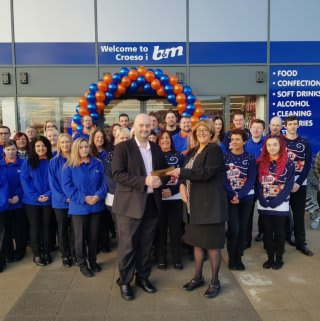 Representatives from charity Ty Olwen Trust accepted £250 worth of B&M vouchers, as a thank you for being the retailer's special guests at its new store opening in Swansea.