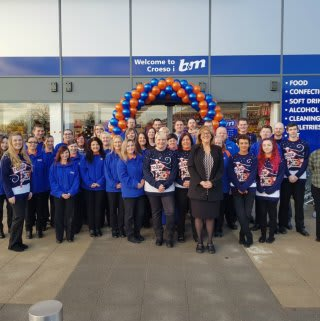 B&M Swansea's store team get ready to open the doors to their first customers on opening day.