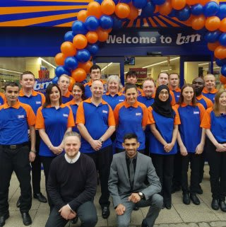 The store team at B&M's new Bishop's Stortford store are all smiles as they open their doors for their first customers.