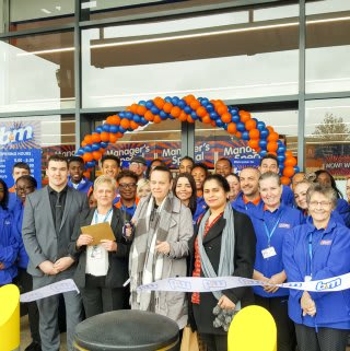 Representatives from Volunteer Centre Lewisham cutting the ribbon at the new B&M Catford