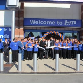 B&M Urmston, Trafford Retail Park is officially opened by the Lord Mayor of Trafford, Councillor John Holder. He is joined by the store team and representatives from Key 103's Cash for Kids charity who received £250 worth of B&M vouchers.