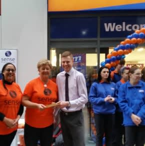 The new Orpington store and representatives from Sense who gratefully accepted £250 worth of B&M vouchers.