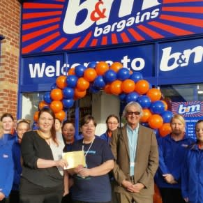 Representatives of The Butterwick Hospice Charity gratefully receiving £250 worth of B&M vouchers.