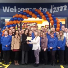 A representative from local charity, the Little Wrens, gratefully receiving £250 worth of B&M vouchers on B&M Bodmin's opening day.