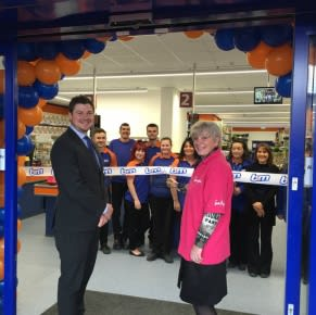 B&M Hucknall being formally re-opened by a Sue Ryder representative, who also gratefully accepted £250 worth of B&M vouchers for the charity.