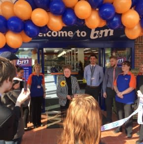 Libby Kendrick of Lindsay Lodge Hospice cut the ribbon at the opening ceremony. B&M Brigg store manager James Smith presented Mrs Kendrick with £250 worth of vouchers, as a thank you for opening the store.