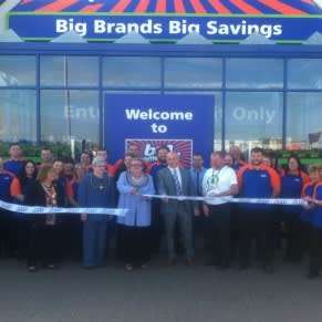 Mayor of Barrow, Councillor Ann Thomson cuts the ribbon on B&M's new store on Hindpool Road. She is joined by representatives from the store's chosen charity, Great North Air Ambulance.