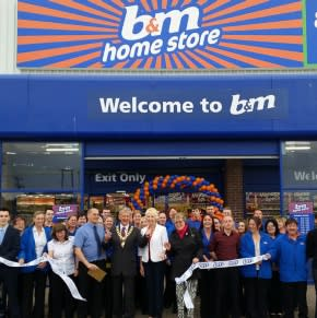 Redruth store being opened by the Chairman of Carn Brae Parish Council – Councillor Bickford and Maggi Lister from the local branch from the RLNI.