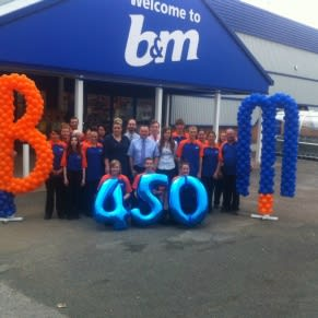 Staff pose outside the brand new B&M Home Store in Tiverton, Devon.