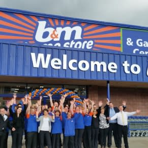 Staff pose outside the new B&M Inverness Home Store & Garden Centre, Telford Retail Park