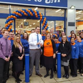 The new Crawley store and Representatives from Sense who gratefully received £250 worth of B&M vouchers.