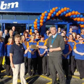 B&M's Local Hero for the opening of B&M Penzance, the RNLI Penlee Lifeboats, gratefully receiving £250 worth of B&M vouchers.