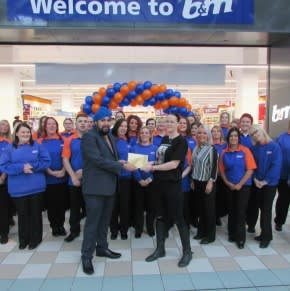 Representatives from Bradley Lowery's Fight receiving £250 worth of B&M vouchers as a thank you for taking part in the opening of B&M Hartlepool - Middleton Grange.
