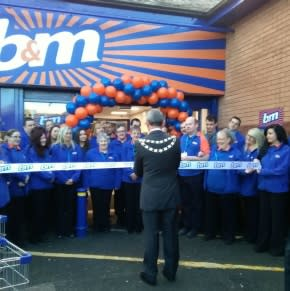 "Mayor Henry Corum cuts the ribbon to declare B&M's latest store in Pwllheli ""open""."