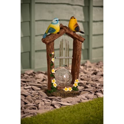 342060-mason-jones-bird-with-solar-light-and-windchime-yellow-flowers