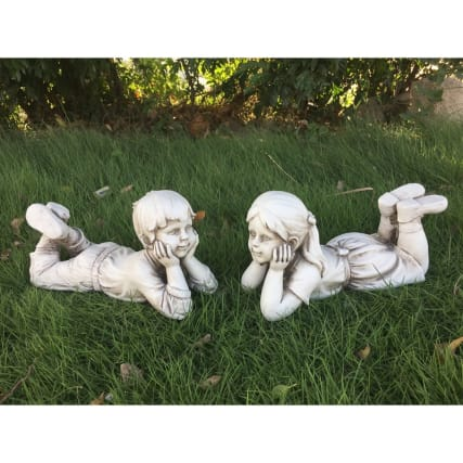 342125-lying-down-girl-and-boy-statue