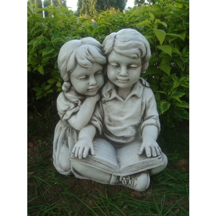 342127-boy-and-girl-reading-statue