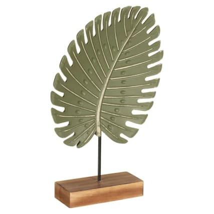 345492-leaft-on-wooden-block-statue-green-2