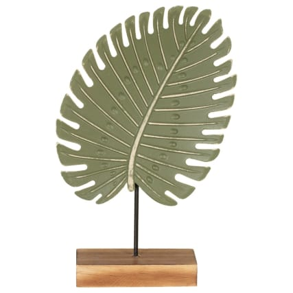 345492-leaft-on-wooden-block-statue-green